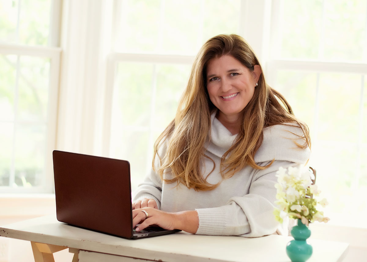 Dolores Hirschmann at her desk